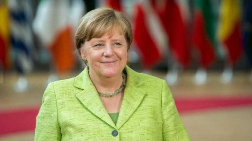 Angela Merkel riceve ad Assisi la lampada della pace