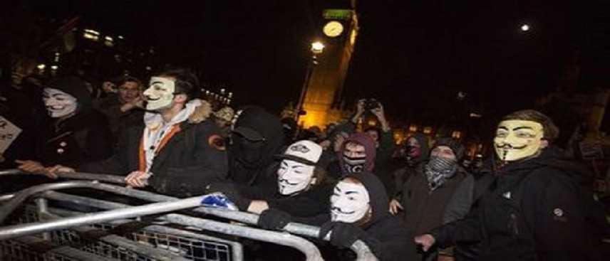 """Gran Bretagna, Anonymous in piazza. Scotland Yard: scontri """"violenze inaccettabili"""""""